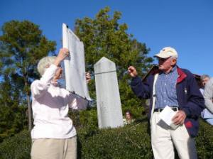 Tille and Baynard Boykin share information about the 1865 battle commemorated by the marker behind them.